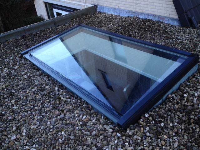 Lichtstraat Lessenaarsdak de Luxe op plat dak met grind